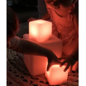 Red Glowing Sensory Blocks With Children Handling Blocks