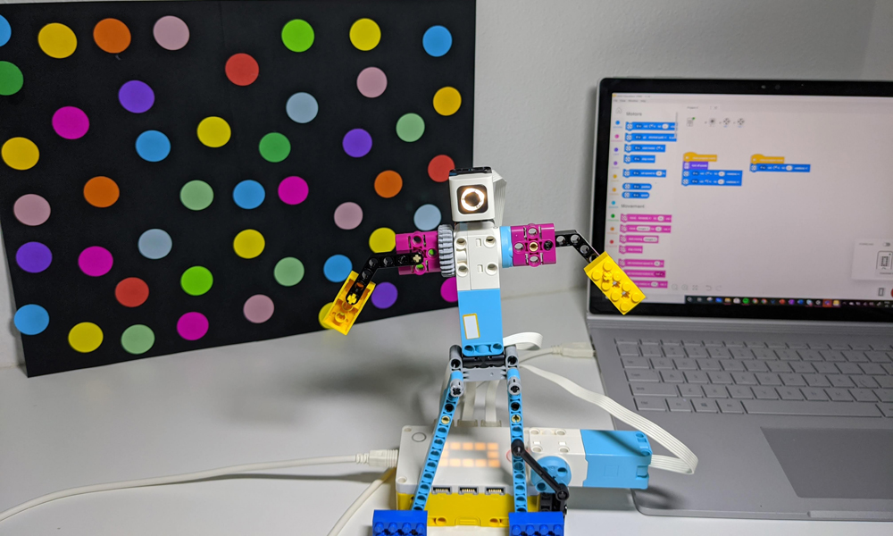 LEGO Education Spike Prime dancing robot with laptop in background