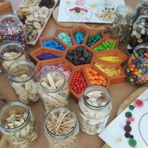 Loose Parts Flower Sorting Tray And Glass Jars On Wooden Desktop