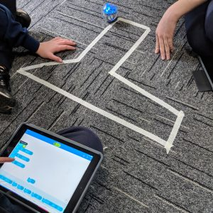 Sphero Maths Activity On Grey Carpet With Masking Tape