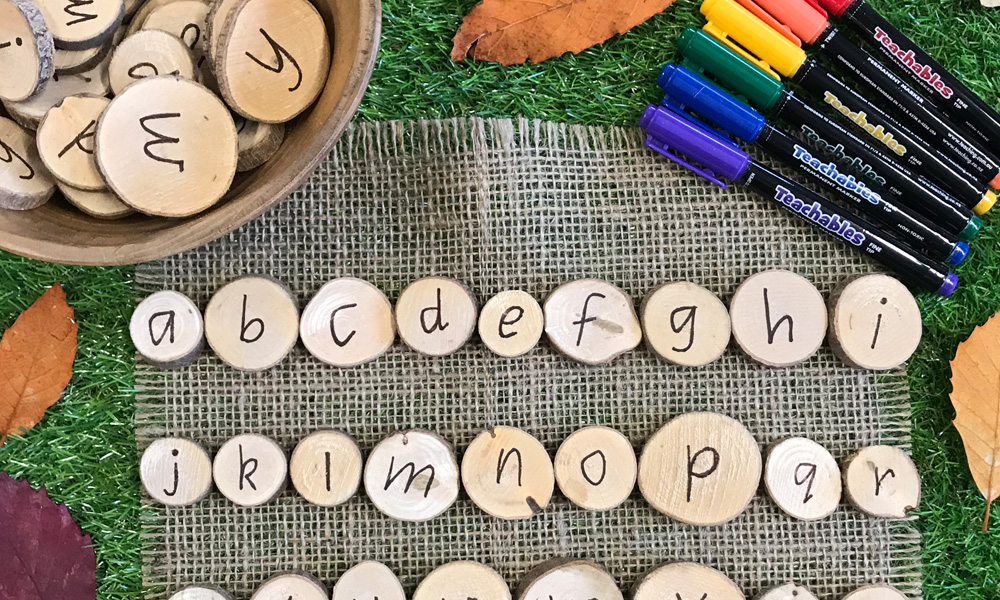 Alphabet Wooden Discs Zoom With Teachables Markers And Leaf Border On Grass