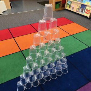 Cup Tower Challenge Transparent Cups Stacked On Coloured Rug