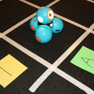 Dash Maths Activity On Grey Carpet With Tape Grid
