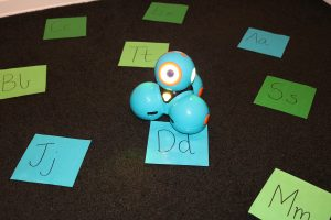 Dash Sound Recognition Activity Blue And Green Letter Paper Cut Outs On Carpet