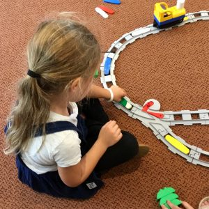 Coding Express Train Tracks With Little Girl Playing