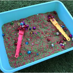 Sorting Christmas Bells In Tray With Rainbow Rice