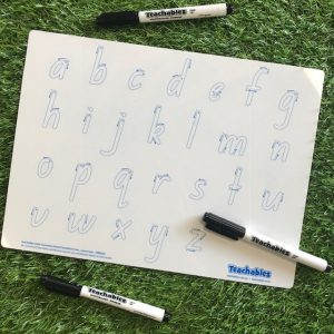 Alphabet Whiteboard With Markers On Grass