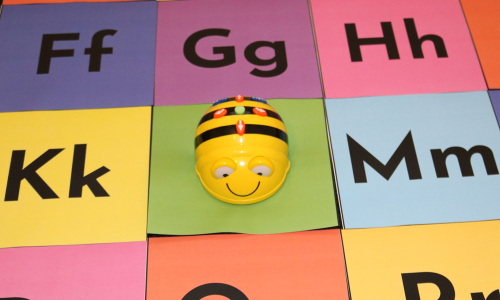 Literacy Bee-Bots Activity Bot On Multi-coloured Upper & Lower Case Letter Grid
