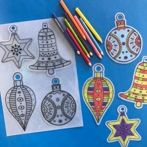 Christmas Colouring Decorations Shrink Art With Coloured Pencils On Blue Background