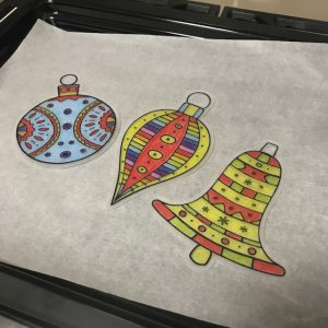 Christmas Decorations In Oven On Baking Paper