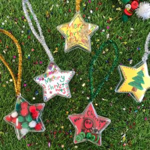 Christmas Star Finished Decorations On Grass With Glitter Stars
