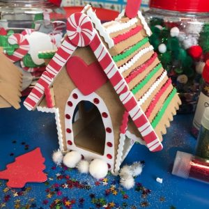 Completed Decorated Christmas Gingerbread House On Blue Desktop