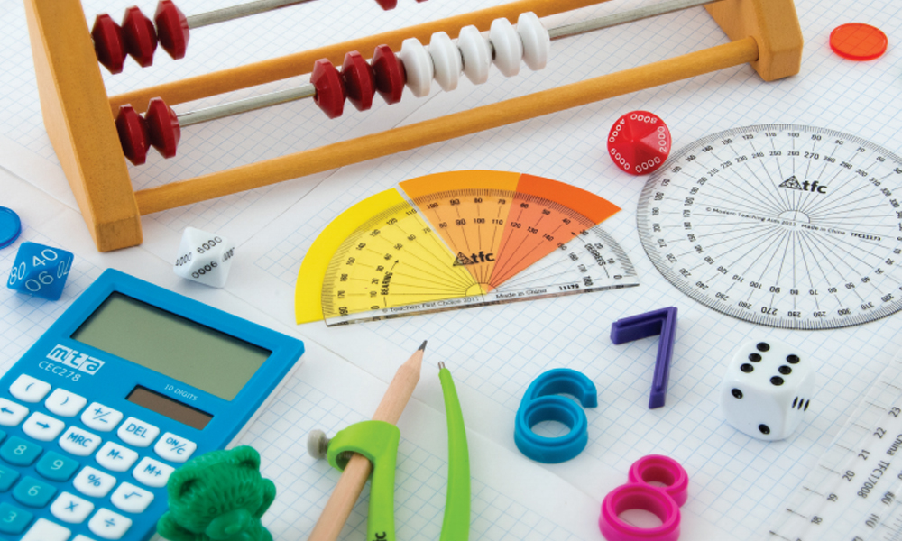 Maths resources displayed on desk, birds eye view