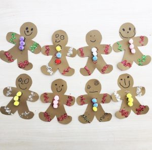 Gingerbread Man Paperchain Decorated On White Background